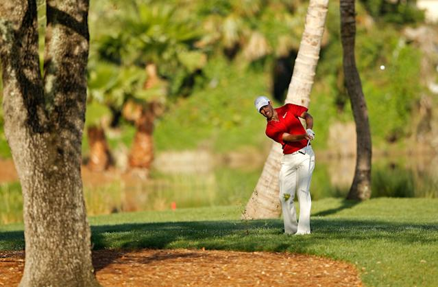 PALM BEACH GARDENS, FL - MARCH 02: Charl Schwartzel of South Africa hits his approach on the 13th hole during the second round of the Honda Classic at PGA National on March 2, 2012 in Palm Beach Gardens, Florida. (Photo by Mike Ehrmann/Getty Images)