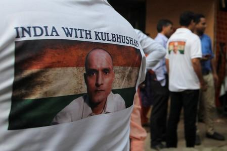 People wait before the issue of a verdict in the case of Indian national Kulbhushan Jadhav by International Court of Justice, in Mumbai