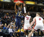 Indiana Pacers guard Aaron Holiday (3) shoots in front of Miami Heat guard Kendrick Nunn (25) during the second half of an NBA basketball game in Indianapolis, Wednesday, Jan. 8, 2020. The Heat won 122-108. (AP Photo/AJ Mast)