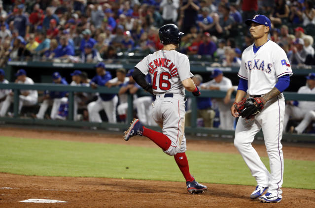 Boston Red Sox's Andrew Benintendi (16) scores the go-ahead run in front of Texas Rangers relief pitcher Keone Kela during the ninth inning of a baseball game Saturday, May 5, 2018, in Arlington, Texas. The Red Sox won 6-5. (AP Photo/Michael Ainsworth)