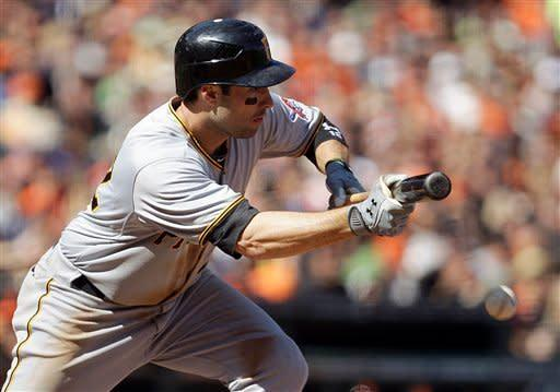 Pittsburgh Pirates' Neil Walker singles on an RBI bunt against the San Francisco Giants during the eighth inning of a baseball game Sunday, April 15, 2012, in San Francisco. The Pirates won 4-1. (AP Photo/Ben Margot)