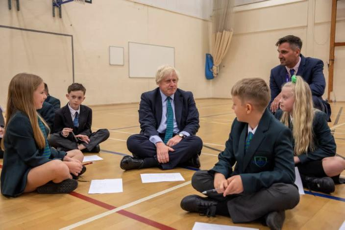 FILE PHOTO: Britain's Prime Minister Boris Johnson visits Castle Rock school on the pupil's first day back to school, in Coalville