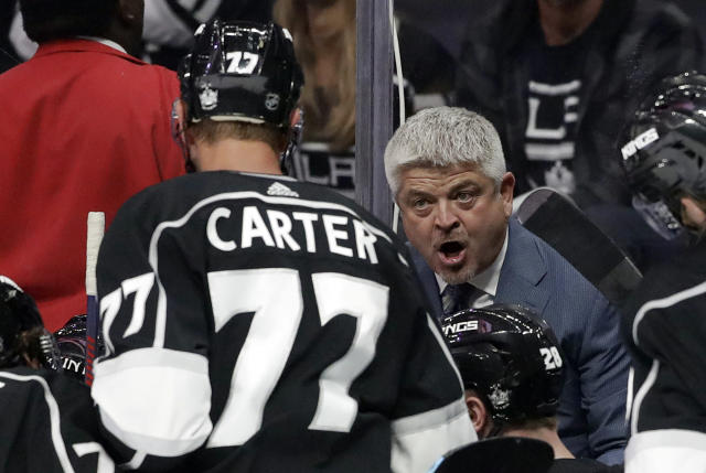 Los Angeles Kings coach Todd McLellan, right, talks to Jeff Carter (77) during the second period of the team's preseason NHL hockey game against the Arizona Coyotes on Tuesday, Sept. 17, 2019, in Los Angeles. (AP Photo/Marcio Jose Sanchez)