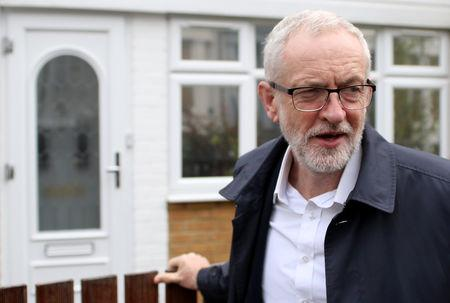 Britain's opposition Labour Party leader Corbyn leaves his house in London