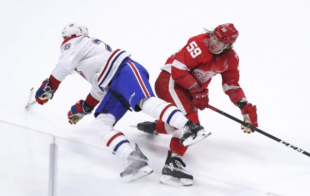 Montreal Canadiens defenseman Jeff Petry (26) trips over Detroit Red Wings left wing Tyler Bertuzzi (59) during the third period of an NHL hockey game Thursday, April 5, 2018, in Detroit. (AP Photo/Carlos Osorio)