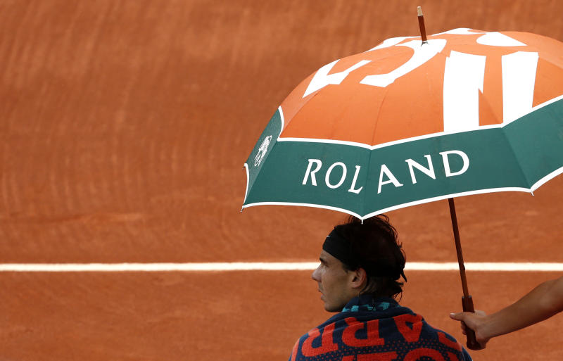 Spain's Rafael Nadal sits on his bench during a break as he plays compatriot Nicolas Almagro during their quarterfinal match in the French Open tennis tournament at the Roland Garros stadium in Paris, Wednesday, June 6, 2012. (AP Photo/Bernat Armangue)