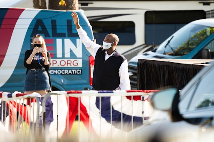 Democratic Senate candidate Jaime Harrison waves to supporters before speaking at a drive-in rally on October 17, 2020 in North Charleston, South Carolina. Harrison is running against incumbent Sen. Lindsey Graham (R-SC). (Photo by Cameron Pollack/Getty Images)