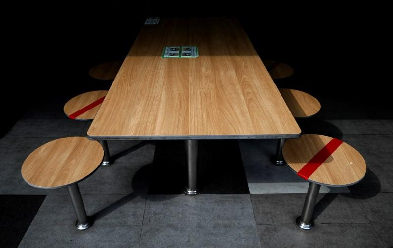 Tables are taped up to encourage social distancing, due to the outbreak of the coronavirus disease (COVID-19), at a food center in Singapore