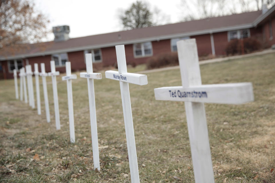 White crosses on the lawn of Good Samaritan Society nursing home Dec. 8, 2020, in Canton, S.D., commemorate residents who have died in recent weeks of the coronavirus. (AP Photo/Stephen Groves)