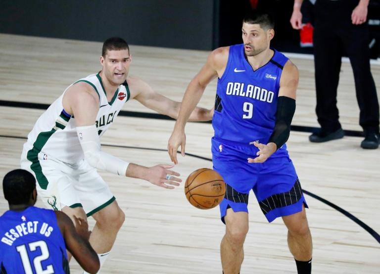 Magic hold on to upend mighty Bucks in playoff opener