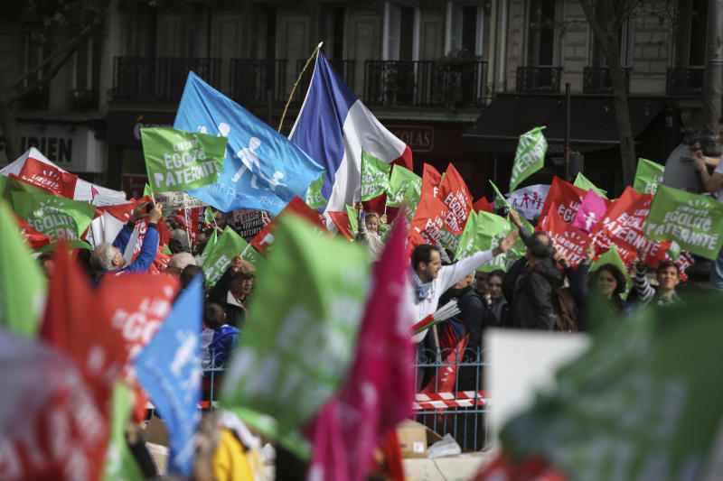 Conservative activists gather to protest in Paris, Sunday Oct. 6, 2019, against a French bill that would give lesbian couples and single women access to in vitro fertilization and related procedures. Traditional Catholic groups and far-right activists organized Sunday's protest, arguing that it deprives children of the right to a father. (AP Photo/Rafael Yaghobzadeh)