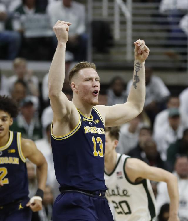 Michigan forward Ignas Brazdeikis reacts after a basket during the first half of the team's NCAA college basketball game against Michigan State, Saturday, March 9, 2019, in East Lansing, Mich. (AP Photo/Carlos Osorio)