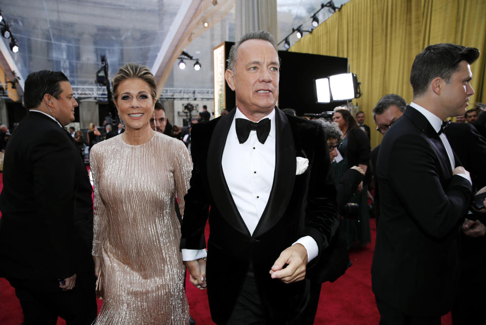 Tom Hanks and Rita Wilson walk on the red carpet during the Oscars arrivals at the 92nd Academy Awards in Hollywood, Los Angeles, California, U.S., February 9, 2020. REUTERS/Mike Blake