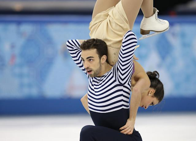 Sara Hurtado and Adria Diaz of Spain compete in the ice dance free dance figure skating finals at the Iceberg Skating Palace during the 2014 Winter Olympics, Monday, Feb. 17, 2014, in Sochi, Russia. (AP Photo/Darron Cummings)
