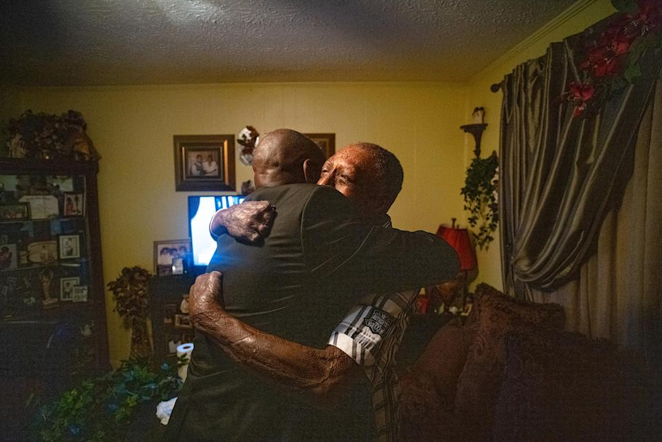 """Crump hugs Curtis Jones, a client who was severely burned after an explosion at a manufacturing facility supplying the Department of Defense, at home in Tallahassee, Fla., on April 3.<span class=""""copyright"""">Ruddy Roye for TIME</span>"""