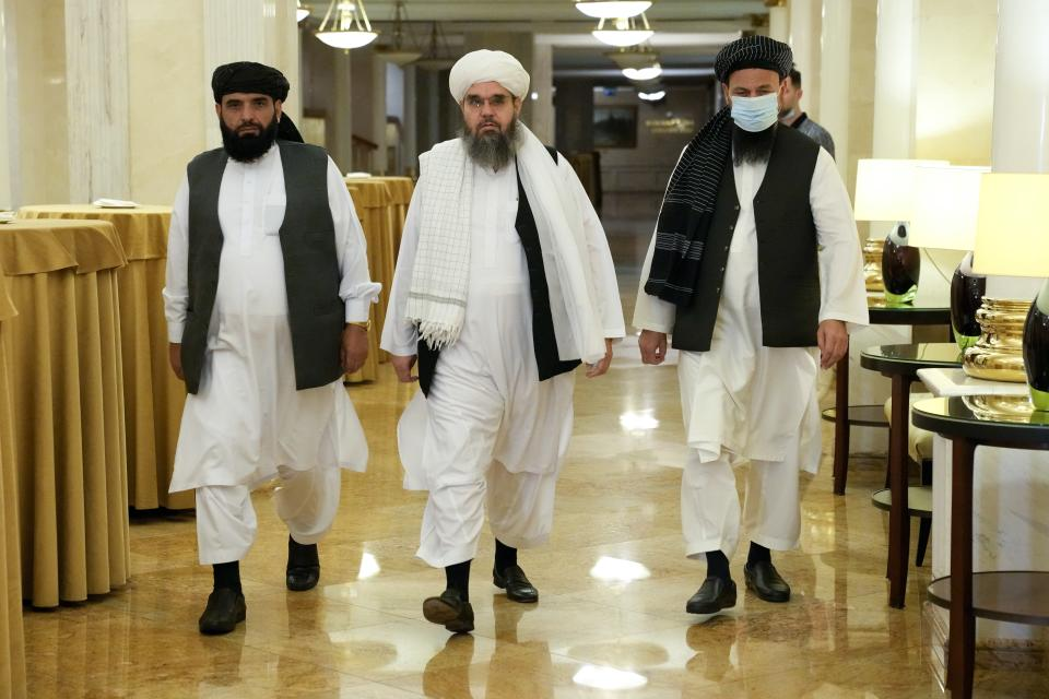 FILE In this file photo taken on Friday, July 9, 2021, Members of political delegation from the Afghan Taliban's movement Suhil Shaheen, left, Mawlawi Shahabuddin Dilawar, center, and Dr, Mohammad Naim, arrive to attend a news conference in Moscow, Russia. Moscow expects the Taliban to fulfill its pledge not to threaten Russia or its allies in Central Asia, Zamir Kabulov, the Kremlin envoy on Afghanistan said in an interview published Wednesday July 14, 2021. Zamir Kabulov, who met with the Taliban delegation that visited Moscow last week, voiced confidence that the Taliban would focus on securing their gains in Afghanistan and wouldn't try to challenge the countries of the region. (AP Photo/Alexander Zemlianichenko, File)