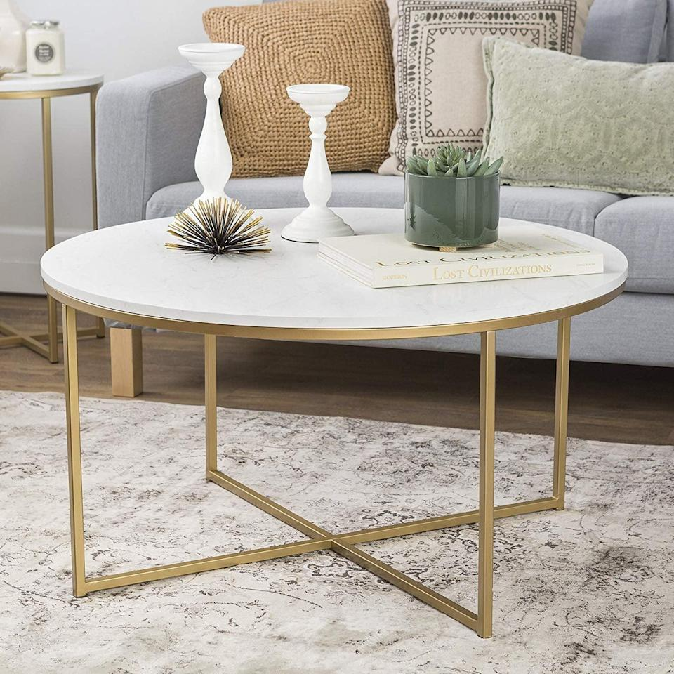 <p>The golden legs of this <span>WE Furniture Coffee Table</span> ($127) add an undeniable touch of elegance. It will enhance your living room and garner tons of compliments.</p>