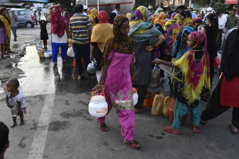 The daily wait for water trucks in the capital has become even worse since the pandemic hit Delhi