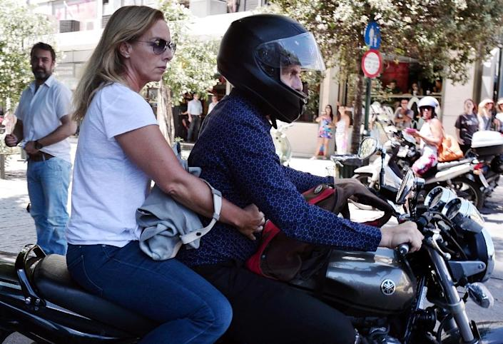 Yanis Varoufakis leaves the finance ministry in Athens on his motorcycle with his wife Danae Stratou on July 6 2015 after his resignation (AFP Photo/Louisa Gouliamaki)