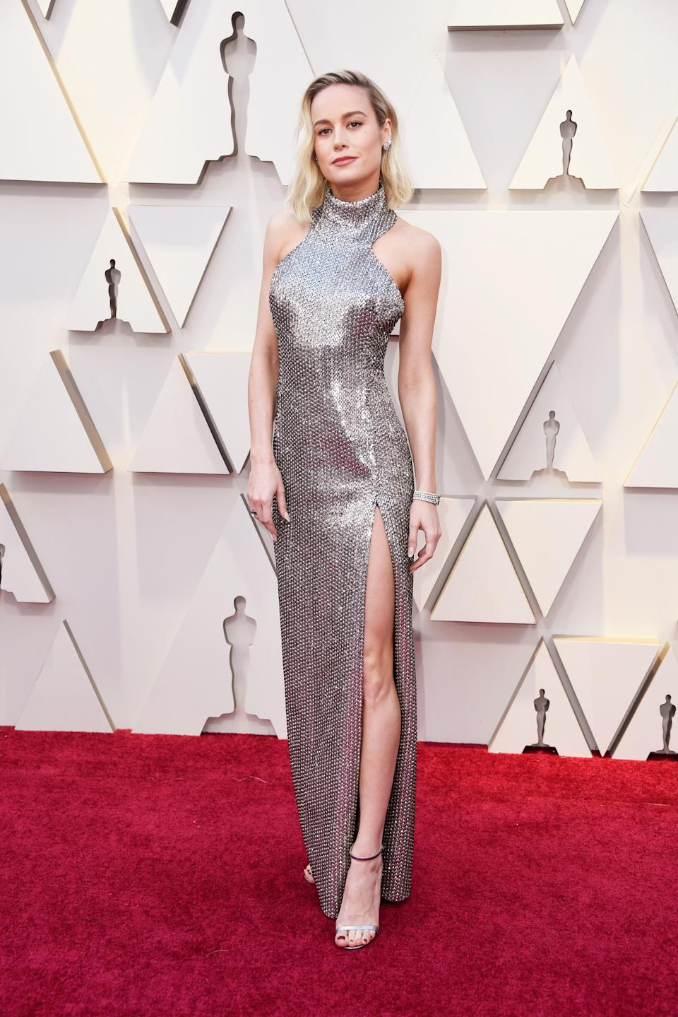 """<p>The """"Captain Marvel"""" star looked out of this world in a silver gown with thigh high slit as she arrived on the red carpet. <em>[Photo: Getty]</em> </p>"""