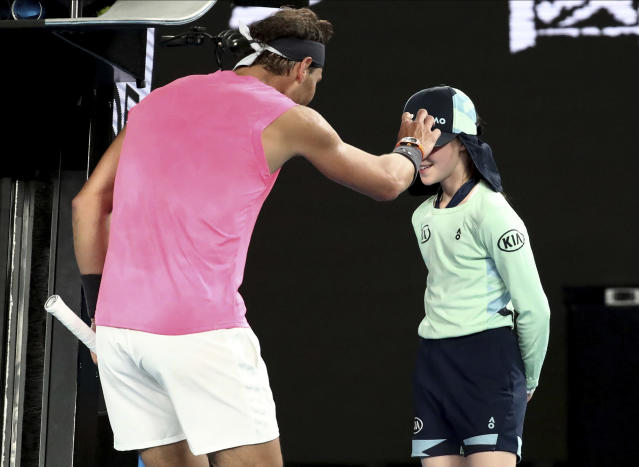 Spain's Rafael Nadal checks a ball girl after a ball hit her during his second round match against Federico Delbonis of Argentina at the Australian Open tennis championship in Melbourne, Australia, Thursday, Jan. 23, 2020. (AP Photo/Dita Alangkara)