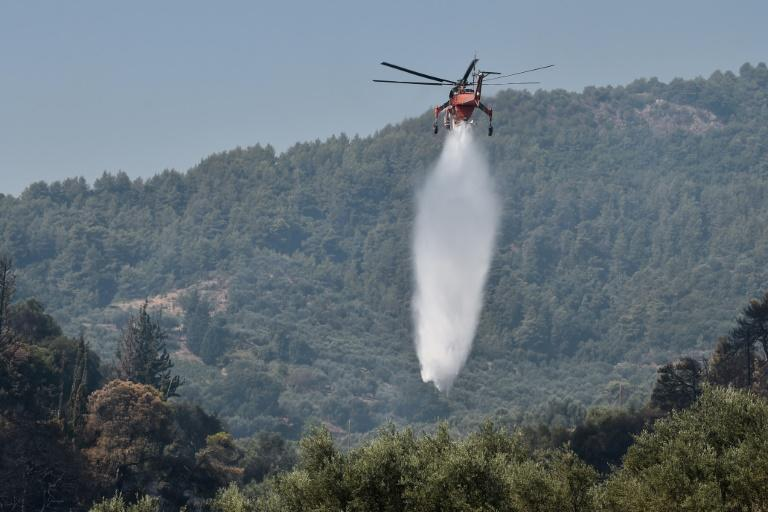 Water-laden helicopters were used in the battle against the fire in Ziria, near Patras