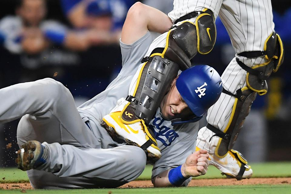 Will Smith gets tangled up with Victor Caratini in the 13th inning.