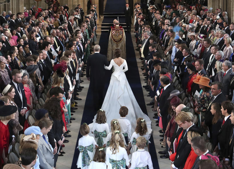 Britain's Princess Eugenie walks down the aisle with her father Prince Andrew.