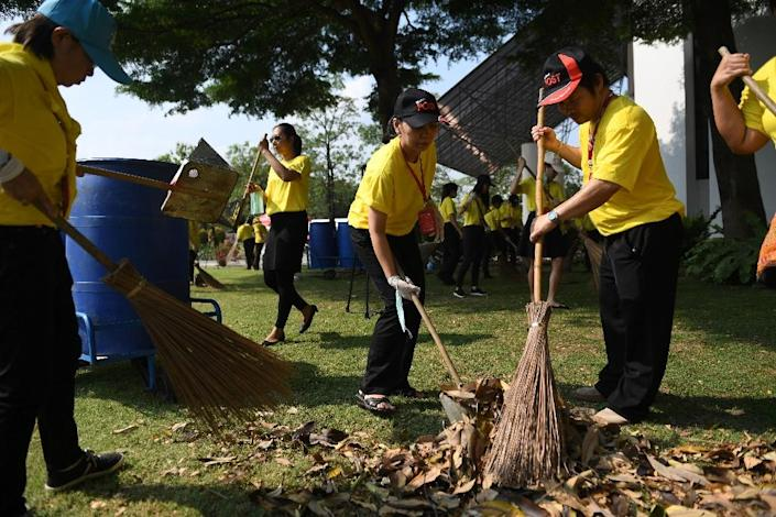 Millions of Thais are taking part in voluntary clean-up programs ahead of the coronation (AFP Photo/Lillian SUWANRUMPHA)