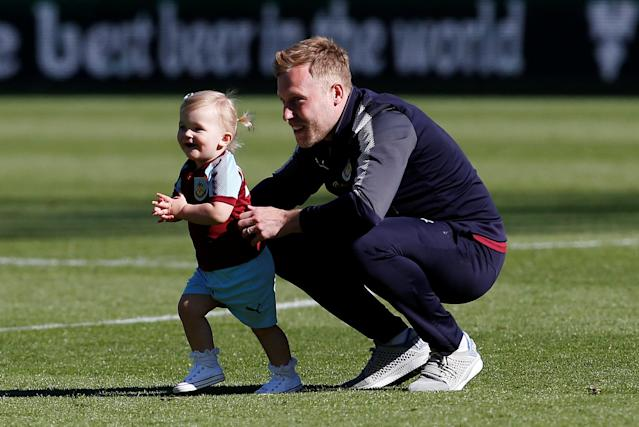 "Soccer Football - Premier League - Burnley vs AFC Bournemouth - Turf Moor, Burnley, Britain - May 13, 2018 Burnley's Scott Arfield celebrates during a lap of honour after the match Action Images via Reuters/Craig Brough EDITORIAL USE ONLY. No use with unauthorized audio, video, data, fixture lists, club/league logos or ""live"" services. Online in-match use limited to 75 images, no video emulation. No use in betting, games or single club/league/player publications. Please contact your account representative for further details."