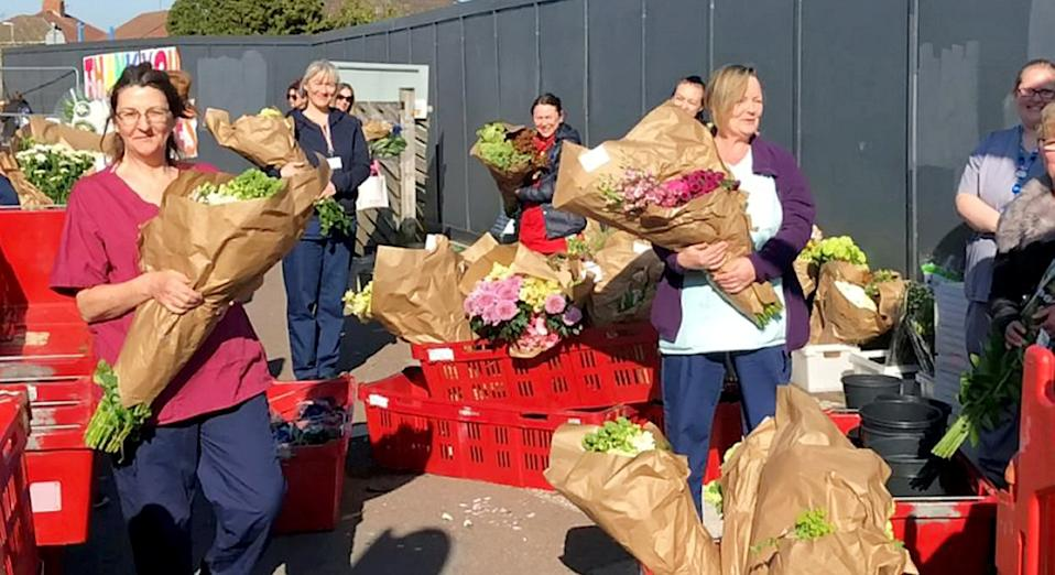 A florist forced to close due to the coronavirus has given away its stock of flowers to NHS staff (SWNS)