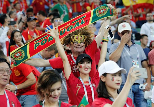 <p>Fans support their teams during the 2018 FIFA World Cup Russia Group B match between Portugal and Spain at the Fisht Stadium in Sochi, Russia on June 15, 2018. (Photo by Fatih Aktas/Anadolu Agency/Getty Images) </p>