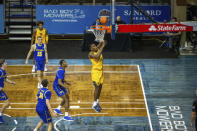 West Virginia forward Oscar Tshiebwe gets past South Dakota State defenders for a layup during an NCAA college basketball game Wednesday, Nov. 25, 2020, in Sioux Falls, S.D. (AP Photo/Josh Jurgens)