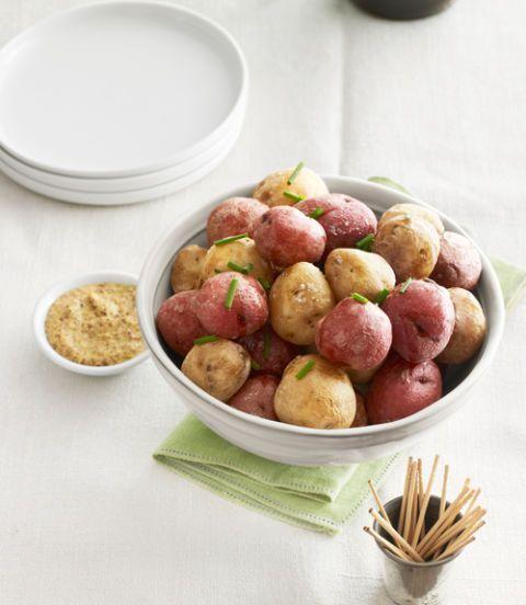 """<p>These crispy-skinned potatoes seasoned with fennel, coriander, and salt and oh so satisfying.</p><p><em><a href=""""https://www.womansday.com/food-recipes/food-drinks/recipes/a38965/salt-baked-new-potatoes-recipes-clv0513/"""" rel=""""nofollow noopener"""" target=""""_blank"""" data-ylk=""""slk:Get the Salt-Baked New Potatoes recipe."""" class=""""link rapid-noclick-resp""""><strong>Get the Salt-Baked New Potatoes recipe.</strong></a></em></p>"""