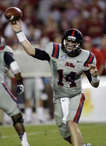 Ole Miss quarterback Bo Wallace (14) throws a pass in the first half of an NCAA college football game against Alabama at Bryant-Denny Stadium in Tuscaloosa, Ala., Saturday, Sept. 29, 2012. (AP Photo/Dave Martin)