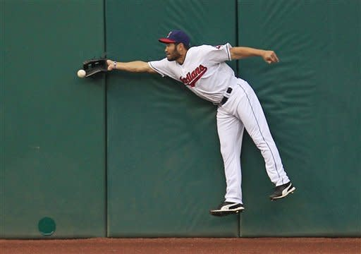 Cleveland Indians' Johnny Damon jumps but cannot make the catch on a double hit by Texas Rangers' Mitch Moreland in the third inning in a baseball game, Friday, May 4, 2012, in Cleveland. (AP Photo/Tony Dejak)
