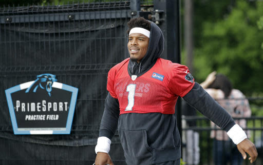 Carolina Panthers' Cam Newton (1) arrives for practice at the NFL football team's facility in Charlotte, N.C., Tuesday, May 22, 2018. While NFL owners are voting to approve the new Panthers owner in Atlanta, the team David Tepper is about to officially own takes to the field for the OTAs back in Charlotte with plenty of new faces.(AP Photo/Chuck Burton)