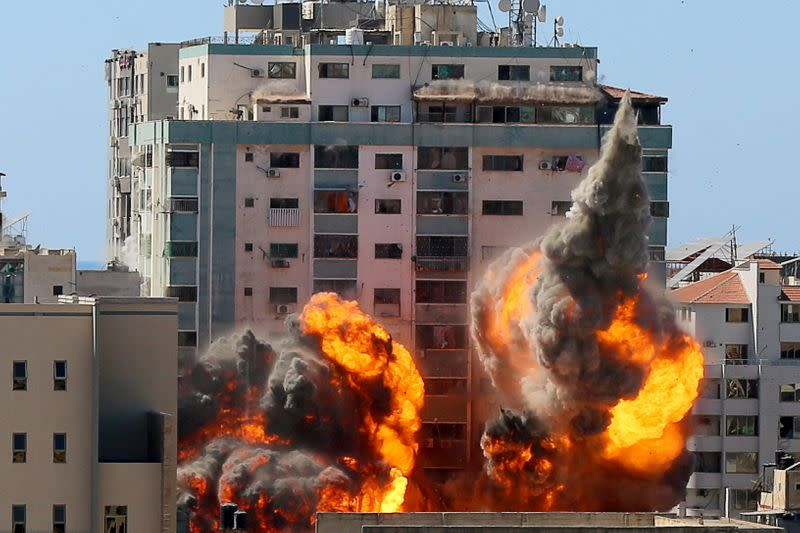 A tower housing AP, Al Jazeera offices collapses after Israeli missile strikes in Gaza city