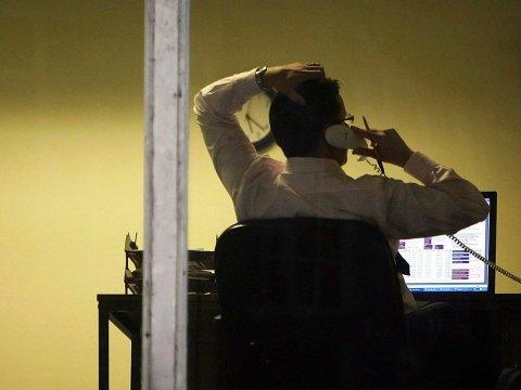 man working late on phone