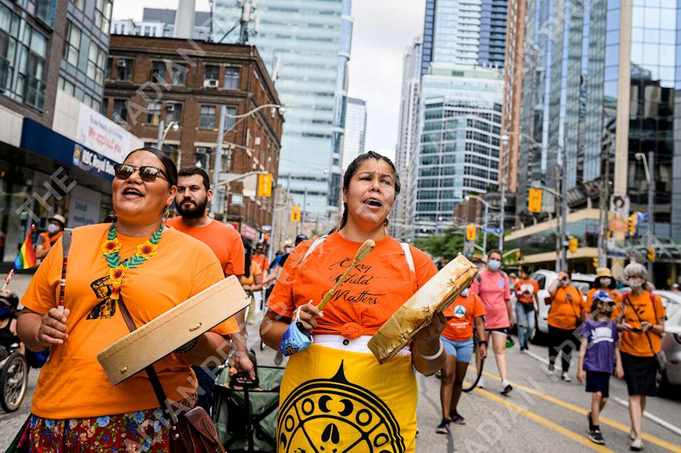 <p>Rosary Spence and Lena Recollet participate in the Every Child Matters Walk on Canada Day, in downtown Toronto on Thursday, July 1, 2021. THE CANADIAN PRESS/Christopher Katsarov</p>