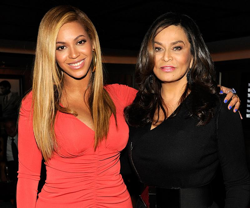Beyoncé with her arm around her mom's shoulder.