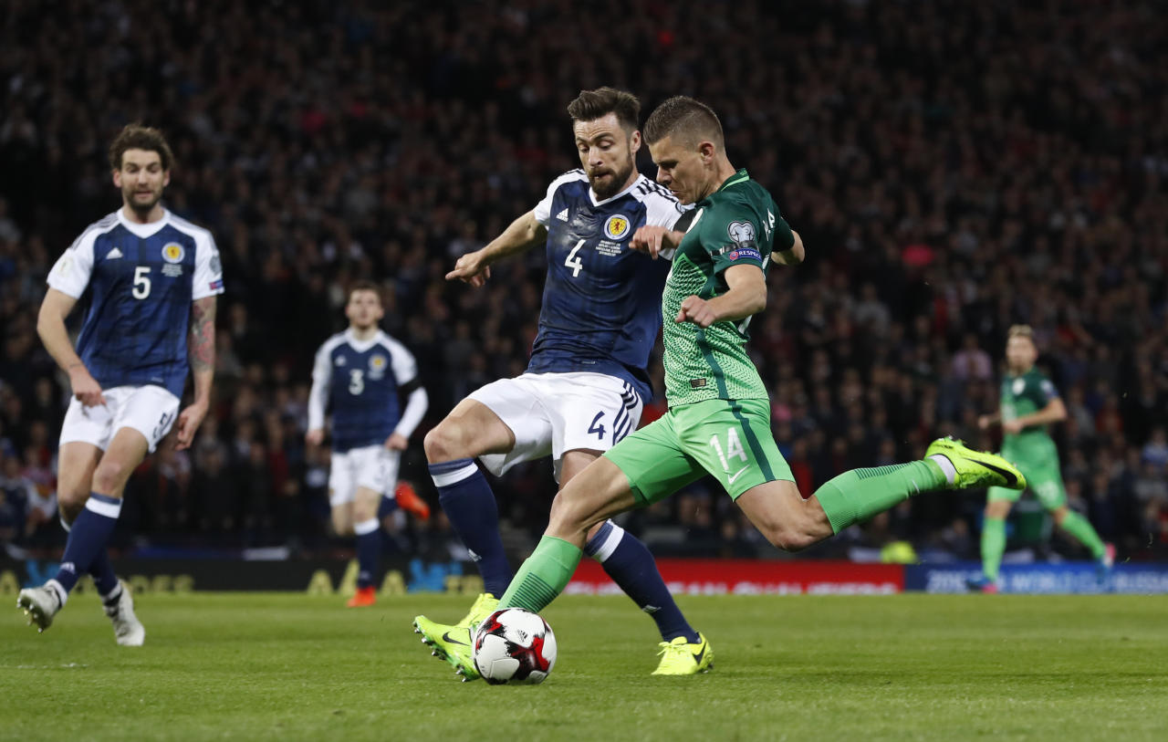 Britain Football Soccer - Scotland v Slovenia - 2018 World Cup Qualifying European Zone - Group F - Hampden Park, Glasgow, Scotland - 26/3/17 Scotland's Russell Martin in action with Slovenia's Roman Bezjak  Reuters / Russell Cheyne Livepic EDITORIAL USE ONLY.