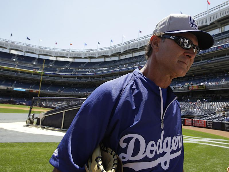Los Angeles Dodgers manager Don Mattingly walks on the field before a baseball game against the New York Yankees Wednesday, June 19, 2013, in New York. (AP Photo/Kathy Willens)