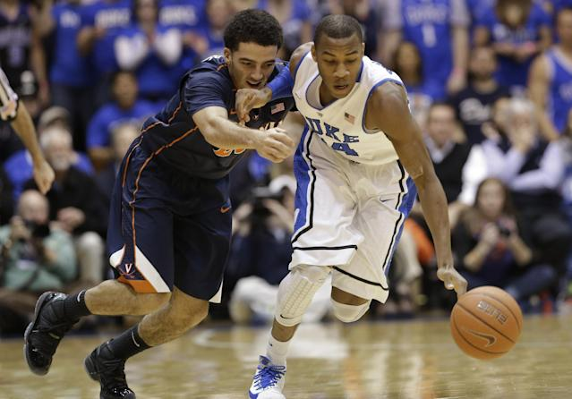 Duke's Rasheed Sulaimon, right, and Virginia's London Perrantes chase a loose ball during the first half of an NCAA college basketball game in Durham, N.C., Monday, Jan. 13, 2014. (AP Photo/Gerry Broome)