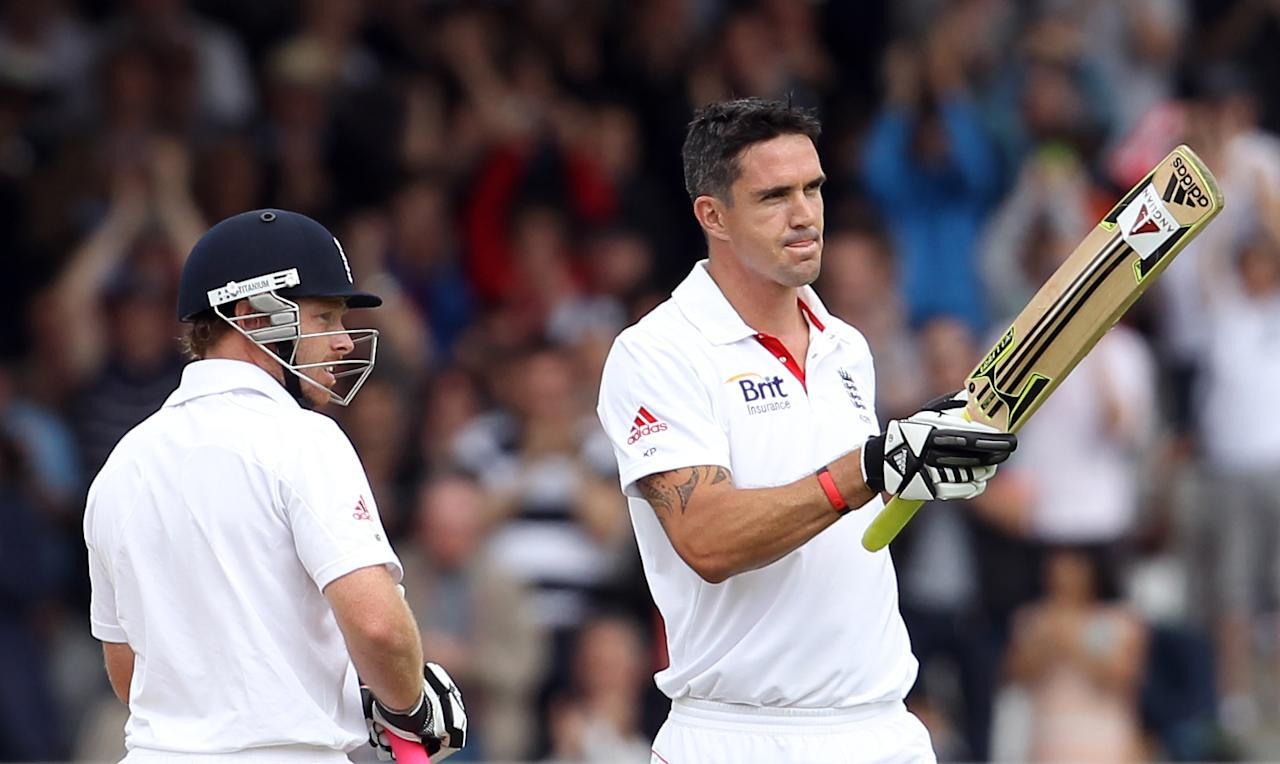 England's batsman Kevin Pietersen (R) celebrates scoring a century against India as Ian Bell (L) looks on during day two of the first test match at Lord's Cricket Ground in London, on July 22, 2011. The match at Lord's is the 2,000th Test match in history and the 100th between England and India. AFP PHOTO / ADRIAN DENNIS  RESTRICTED TO EDITORIAL USE. NO ASSOCIATION WITH DIRECT COMPETITOR OF SPONSOR, PARTNER, OR SUPPLIER OF THE ECB (Photo credit should read ADRIAN DENNIS/AFP/Getty Images)