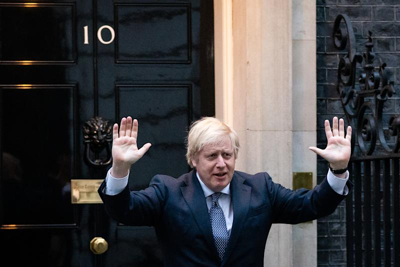 Prime Minister Boris Johnson stands outside 10 Downing Street in London as he joins in the applause to salute local heroes during Thursday's nationwide Clap for Carers to recognise and support NHS workers and carers fighting the coronavirus pandemic.