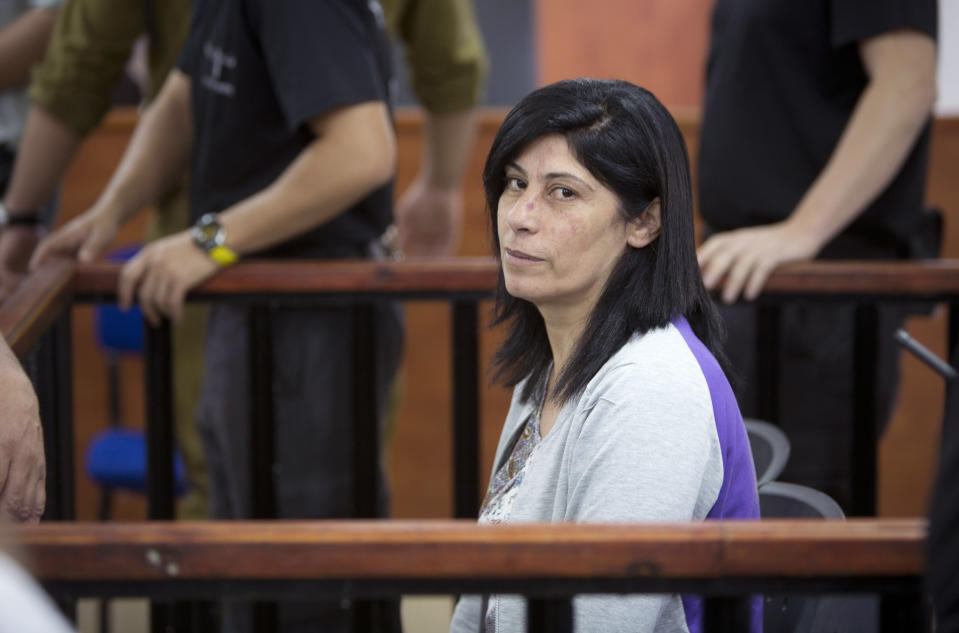 FILE - This May 21, 2015 file photo shows Palestinian Parliament member Khalida Jarrar of the Popular Front for the Liberation of Palestine (PFLP) attending a court session at the Israeli Ofer military base near the West Bank city of Ramallah. An Israeli military court has sentenced Jarrar, Tuesday, March 2, 2021, to two years in prison in a plea bargain that convicted her of belonging to an outlawed group but dropped the most serious charges against her. (AP Photo/Majdi Mohammed, File)