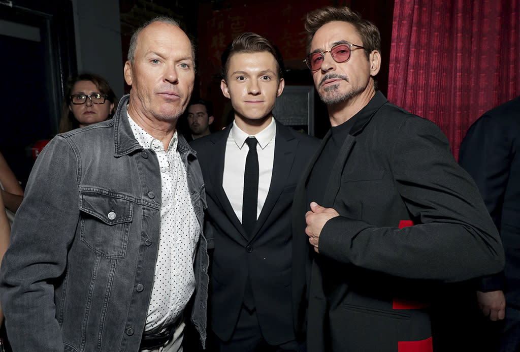 """<p>The Vulture and Tony Stark surround Spidey himself at the <a rel=""""nofollow"""" href=""""https://www.yahoo.com/movies/film/spider-man-homecoming""""><em>Spider-Man: Homecoming</em></a> premiere at TCL Chinese Theatre on June 28, 2017, in Hollywood. (Photo: Eric Charbonneau/Invision/AP Images) </p>"""