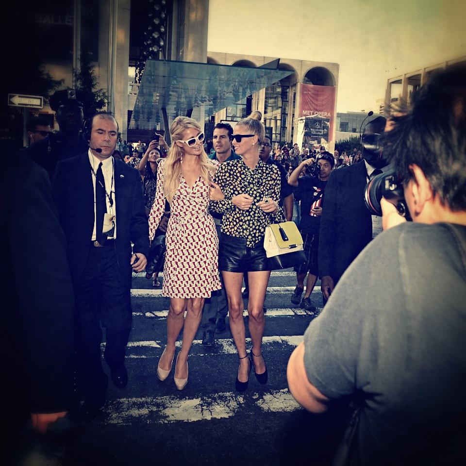 NEW YORK, NY - SEPTEMBER 09:  (EDITORS NOTE: Image was processed using an Instagram filter) Paris Hilton and Nicky Hilton walk during Fashion Week at Lincoln Center on September 9, 2012 in New York City.  (Photo by Larry Busacca/Getty Images)
