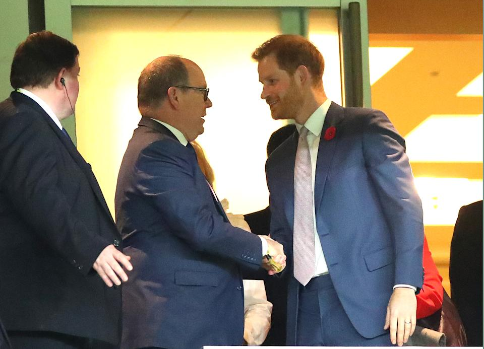 YOKOHAMA, JAPAN - NOVEMBER 02: Prince Harry, Duke of Sussex (R) shakes hands with Albert II, Prince of Monaco in the stands during the Rugby World Cup 2019 Final between England and South Africa at International Stadium Yokohama on November 02, 2019 in Yokohama, Kanagawa, Japan. (Photo by Cameron Spencer/Getty Images)